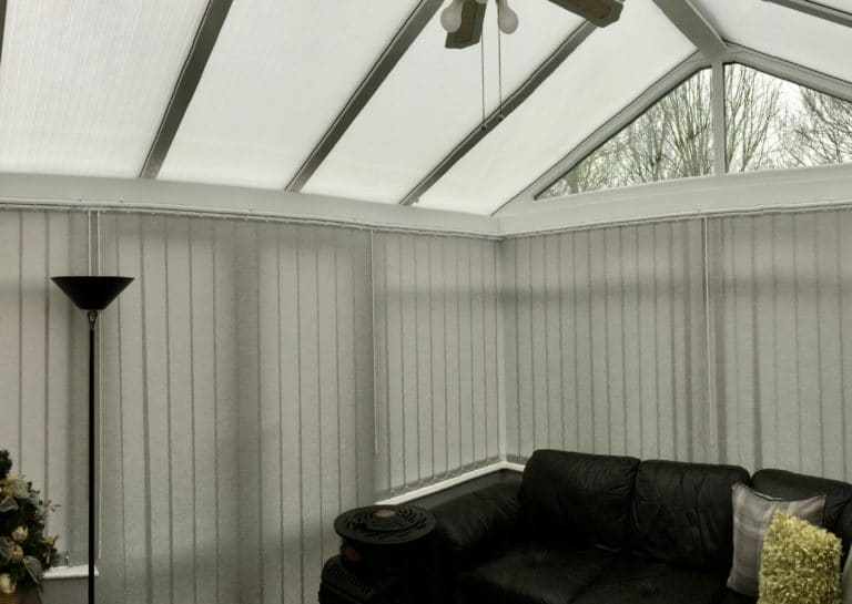 Grey Vertical Blinds In Conservatory