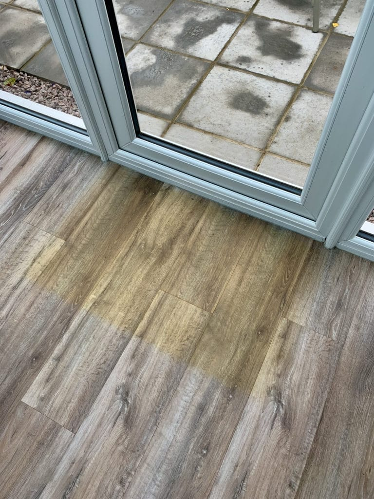 faded floor with mat mark