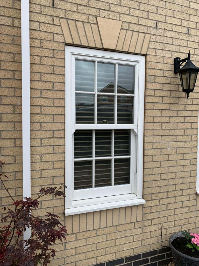 window with blinds from outside house
