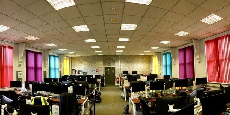 office with colourful vertical blinds on each window