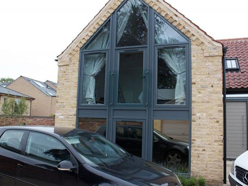 This Lincoln Barn conversion cathedral gable had no privacy and got too warm in the evening.