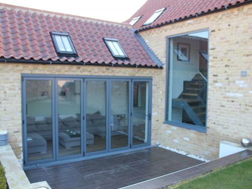 The high spec wooden flooring in front of these bifold doors saw serious sun damage only 18 months after installation.